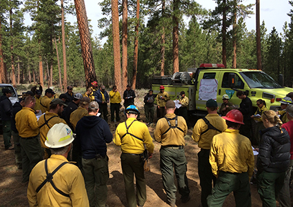 Central Oregon TREX participants receiving a morning briefing on the day's prescribed fire operation.
